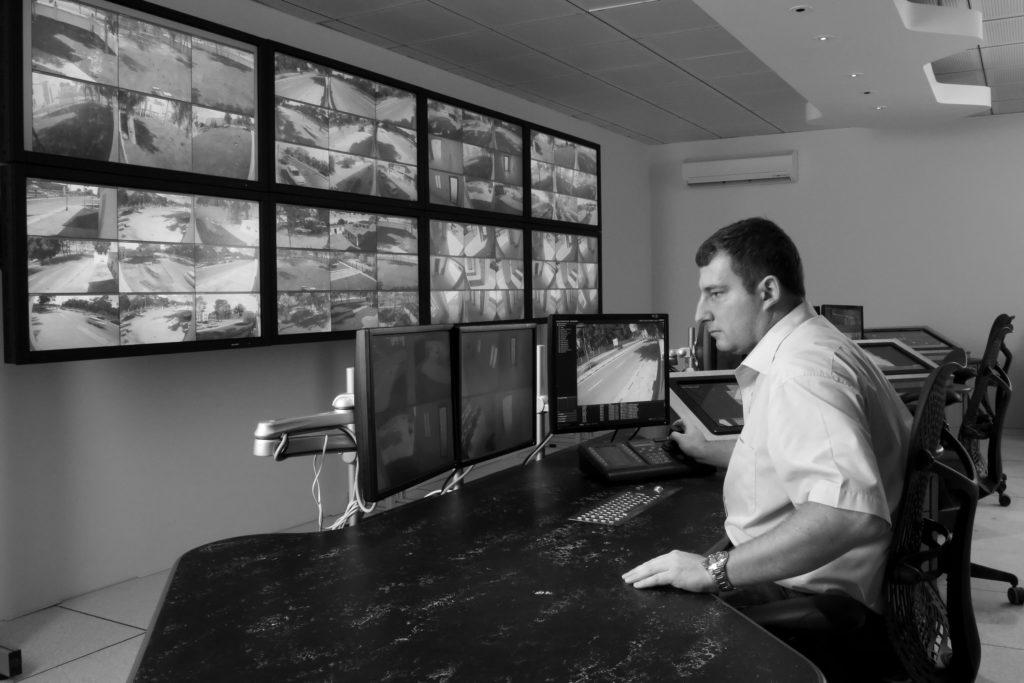 Man monitoring cctv cameras in  high-end cctv surveillance room